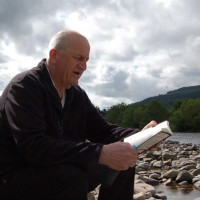 Tom reads at river Spey at Ballindalloch Estate
